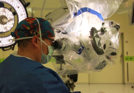 A neurosurgeon looks through an eyepiece on the KINEVO 900 microscope at Hadassah Ein Kerem