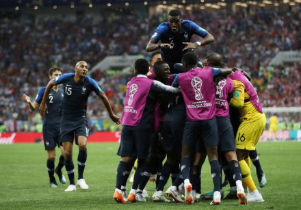France's Kylian Mbappe celebrates scoring their fourth goal with teammates, July 15, 2018