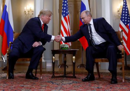 U.S. President Donald Trump and Russia's President Vladimir Putin shake hands they meet in Helsinki
