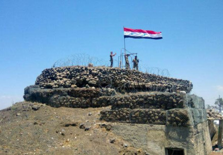 Syrian forces of President Bashar Assad are seen on al-Haara hill in Quneitra area, Syria