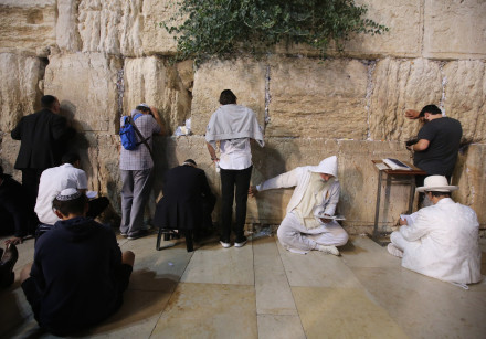 Men pray at the Western Wall, Tisha B'av, 2018