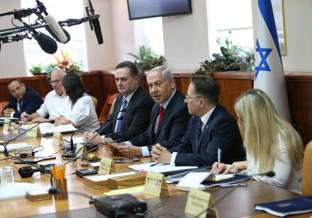 Prime Minister Benjamin Netanyahu sitting with cabinet at government meeting on July 23, 2018