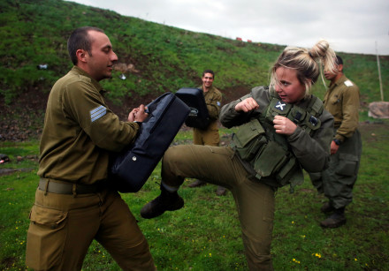 A female Israeli soldier takes part in a training session in Krav Maga at a military base