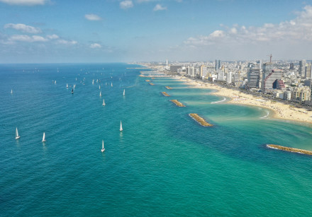 The traditional sail-by of the Sail Tel Aviv - Yaffo watersports festival