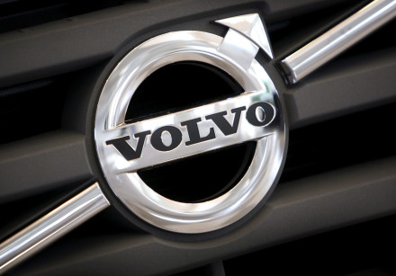 The logo of Volvo is seen on the front grill of a Volvo truck in a customer showroom at the company'