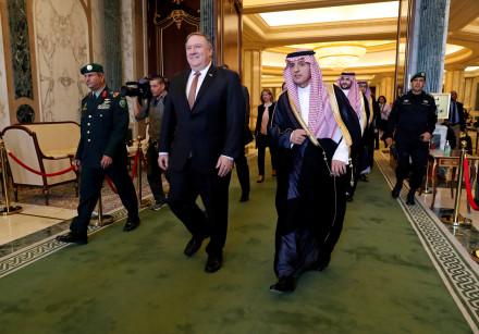 U.S. Secretary of State Mike Pompeo walks with Saudi Foreign Minister Adel al-Jubeir in Riyadh