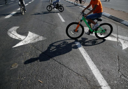 Children ride their bicycles on an empty road during the Jewish holiday Yom Kippur in Jerusalem.