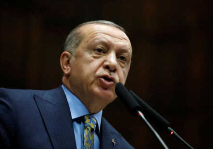 Turkish President Tayyip Erdogan addresses members of parliament from his ruling AK Party (AKP)