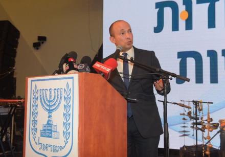 Education Minister Naftali Bennett speaking at a conference.