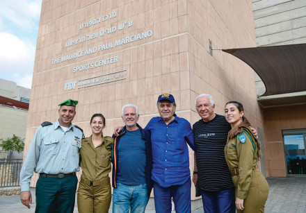 FROM LEFT, Avi Motola, Maurice Marciano, Haim Saban, Paul Marciano with IDF soldiers