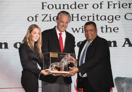 "Mike Evans received the Jerusalem Post's ""Lion of Jerusalem"" award by its CEO Ronit Hassin-Hochman a"