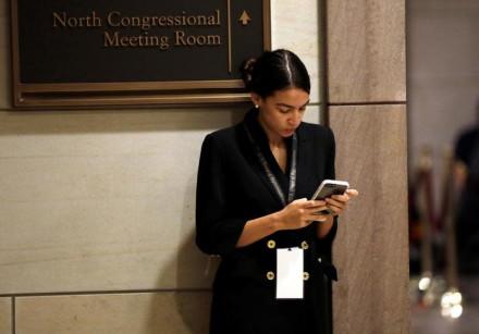 Alexandria Ocasio-Cortez waits for a House of Representatives member-elect welcome briefing