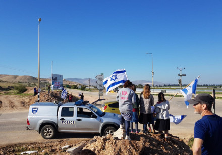 Dozens of demonstrators protested at the Mehola Junction in the Jordan Valley