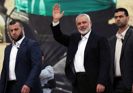 Hamas Chief Ismail Haniyeh gestures during a rally marking the 31st anniversary of Hamas' founding,