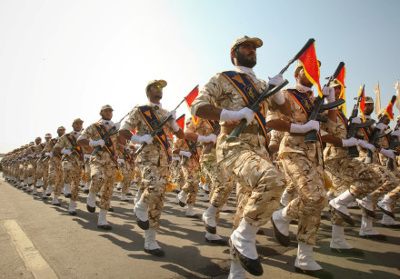 Members of the Iranian Revolutionary Guards march during a parade to commemorate the anniversary of