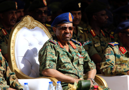 Sudan's President Omar Ahmed al-Bashir looks on during Sudan's Saudi Air Force show during the final