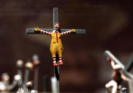 A figure of a crucified Ronald McDonald