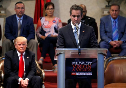 President Donald Trump listens as his former personal attorney Michael Cohen delivers remarks