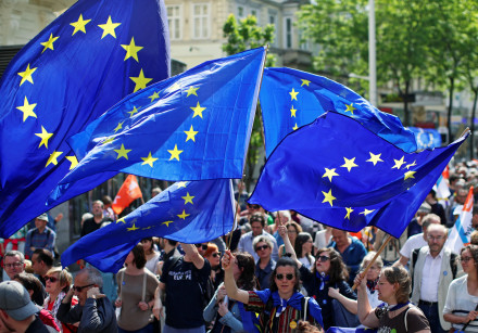 People wave European union flags