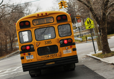 A school bus used for transporting New York City public school students is seen driving down 135th a