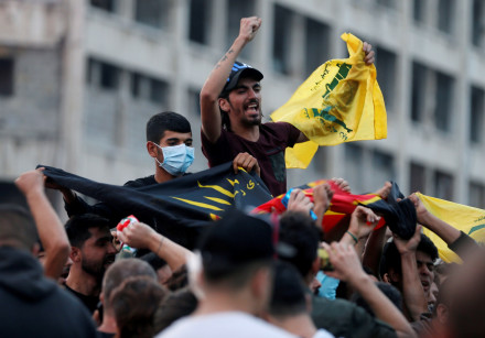 Supporters of Lebanon's Hezbollah leader Sayyed Hassan Nasrallah carry the party's flag in Beirut