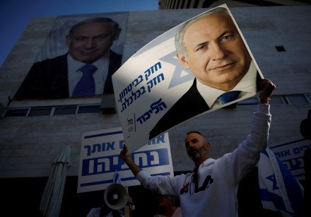 Supporters of Israeli Prime Minister Benjamin Netanyahu protest outside Likud Party headquarters in