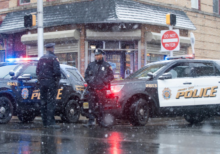 Jersey City police work at the scene the day after an hours-long gun battle at a kosher supermarket