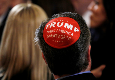 "A participant wears a Trump ""Make America Great Again"" yarmulke as they attend a White House Hanukka"