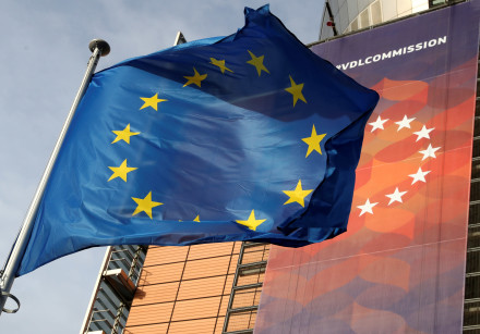 A European Union flag flies outside the European Commission headquarters in Brussels, Belgium, Decem