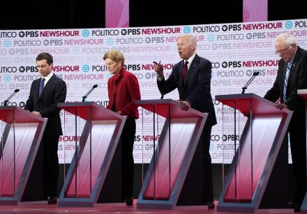 Former Vice President Joe Biden speaks as South Bend Mayor Pete Buttigieg, Senator Elizabeth Warren,