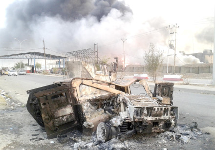 A BURNED vehicle is seen during clashes between Iraqi security forces and ISIS in Mosul in 2014.