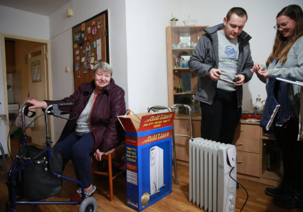 """The """"Warming With Fellowship"""" initiative by the IFCJ provides the Israeli elderly with winter gear."""