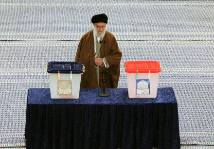 Iran's Supreme Leader Ayatollah Ali Khamenei casts his vote at a polling station during parliamentar