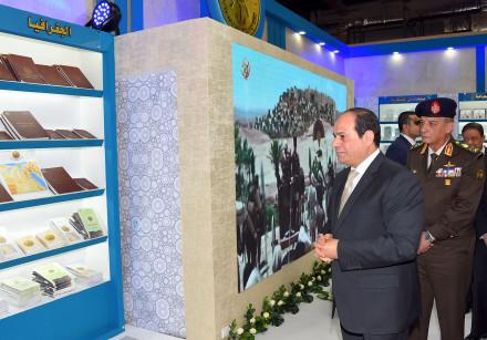 Egypt's President Abdel Fattah al-Sisi (L) attends the opening ceremony of the 50th Cairo Internatio