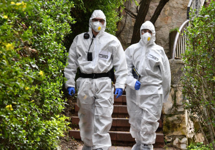 Police officers in coronavirus protective suits
