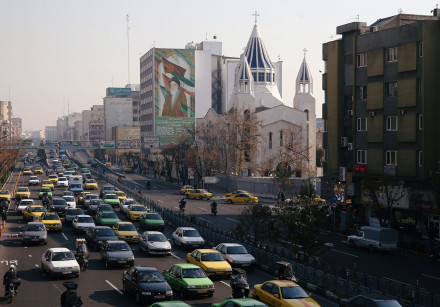 Saint Sarkis Cathedral and a building with a mural of Iran's late leader Ayatollah Ruhollah Khomeini