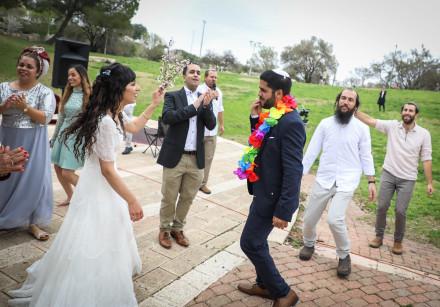 HANANEL EVEN HEN and Shiran Habush celebrate during their corona-era wedding at an Efrat public park