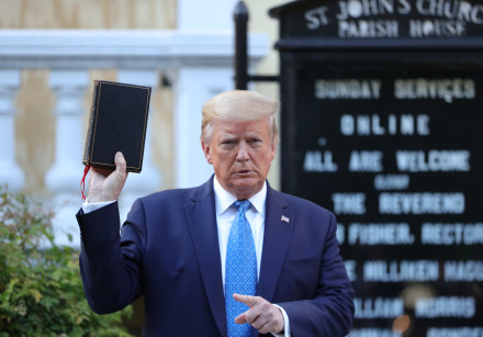 US President Donald Trump holds up a Bible in front of St. John's Episcopal Church, June 1, 2020.