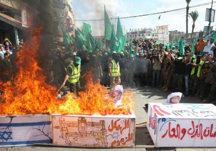 Hamas members burn coffin draped in Israeli flag, rally marking 13th anniversary of Second Intifada