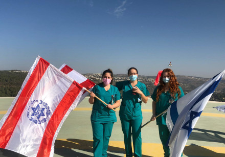 Hadassah Ein Kerem coronavirus department staff, on the roof of the hospital