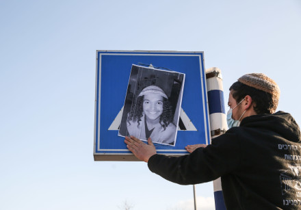 Israelis attend a protest in Tzfat, following the death of a young settler. Ahuvia SAndak, 16, was k
