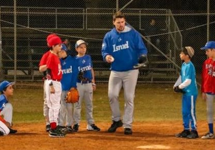 FORMER MAJOR LEAGUER and Israel Olympic National Team catcher Ryan Lavarnway (center) coaches young
