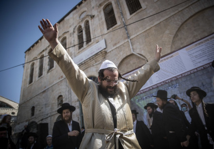 Ultra orthodox jewish men dance during celebrations of the Jewish holiday of Lag Baomer in the ultra