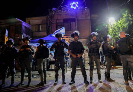Israeli security forces clash with protesters outside a home of a Jewish family during a protest aga