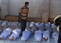 Syrian activists inspect bodies of people they say killed by nerve gas in Damascus August 21, 2013