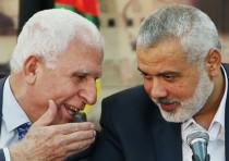 Azzam al-Ahmad and Ismail Haniyeh.