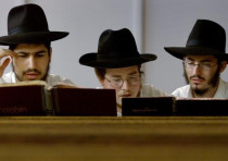 Yeshiva students pray in a synagogue