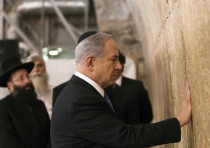 Prime Minister Benjamin Netanyahu touches the stones of the Western Wall