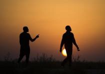 African migrants walk outside Holot open detention center in Israel's southern Negev desert
