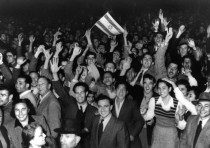Jews celebrate in the streets of Tel Aviv moments after the United Nations voted November 29, 1948.